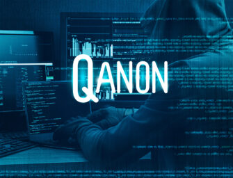 What is QAnon about, and why is it considered a danger to democracy?